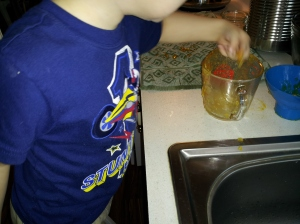 Licking up the drippings was a task this three-year old was happy to take on